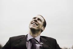 Businessman Listening Music Through Headphones Royalty Free Stock Images