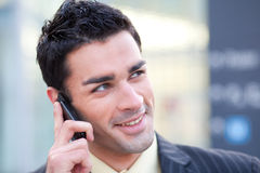 Businessman listening at phone Stock Image