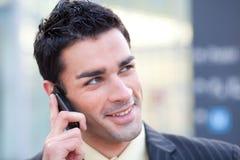 Businessman listening at phone Stock Image