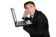 Businessman listening to computer Stock Image