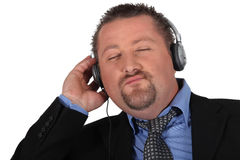Businessman listening to music Stock Image