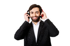 Businessman listening to music. Royalty Free Stock Images