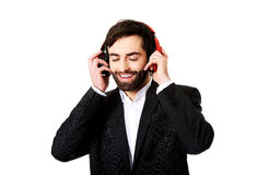 Businessman listening to music. Stock Photography