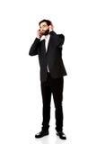 Businessman listening to music. Stock Photo