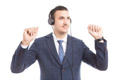 Businessman listening to music and dancing stock photo