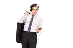 Businessman listening to music on his cell phone Stock Images