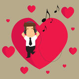 Businessman listening to the music of love in what they do.  Royalty Free Stock Photography