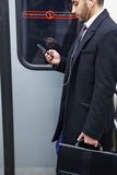 Businessman Listening to Music in Subway Train royalty free stock images