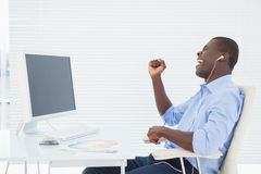 Businessman listening to music while he works Stock Photography