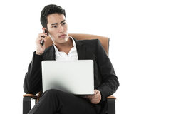 Businessman listening to a phone call Stock Photos
