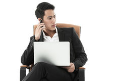 Businessman listening to a phone call Stock Images
