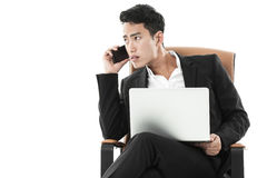 Businessman listening to a phone call Royalty Free Stock Photos