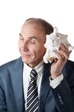 Businessman listening to the shell. At white background royalty free stock photo