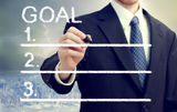 Businessman Listing Goals. Businessman listing his goals with cityscape background Stock Photography