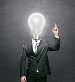 Businessman with lit light bulb as a head royalty free stock photo