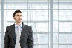 Businessman in lobby Stock Photo