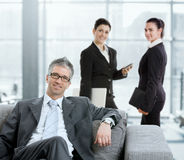 Businessman in lobby Stock Photos