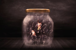 Businessman locked into a jar with question marks concept Royalty Free Stock Photos