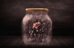 Businessman locked into a jar with question marks concept Royalty Free Stock Image