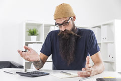 Businessman with long beard is really surprised Royalty Free Stock Photography