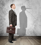 Businessman with long nose stock image