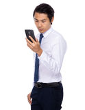 Businessman look at the cellphone Royalty Free Stock Images