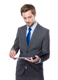 Businessman look at clipboard Stock Photo