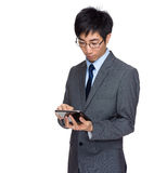 Businessman look at digital tablet Stock Photography