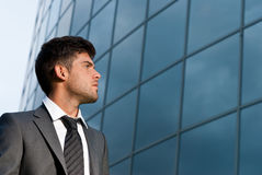 Businessman look good expectations modern building. Young businessman looking good expectations on modern building background royalty free stock photography