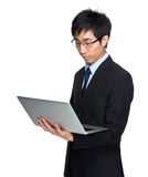 Businessman look at laptop computer Royalty Free Stock Photography