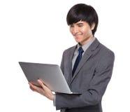 Businessman look at laptop Stock Image