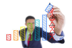 Businessman look up and writing graph bar growth. Concept business draw graph bar growth by teamwork above whiteboard white background Stock Photography
