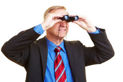 Businessman looking through Royalty Free Stock Photography
