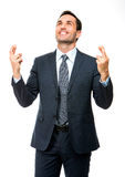 Businessman looking above fingers crossed Royalty Free Stock Images