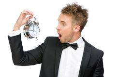 Businessman looking at alarm clock Royalty Free Stock Photo