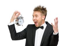 Businessman looking at alarm clock and shouting royalty free stock images