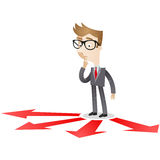 Businessman looking at arrows on floor Royalty Free Stock Photography