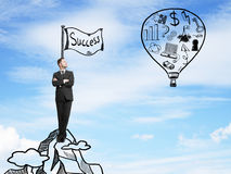 Businessman looking on balloon. With drawing business symbol. success concept Royalty Free Stock Photography