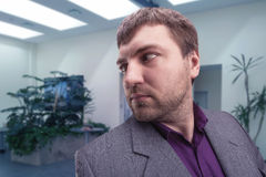 Businessman looking behind himself Stock Photos