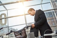 Businessman is looking for bicycle key royalty free stock photos
