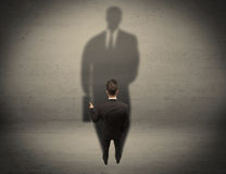Businessman looking at big shadow concept Royalty Free Stock Photography