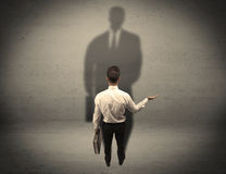 Businessman looking at big shadow concept Stock Image