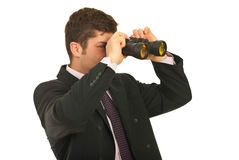Businessman looking through binocular Stock Photography