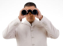 Businessman looking through binocular Stock Photo