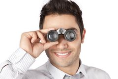 Businessman Looking Through Binocular Royalty Free Stock Photos