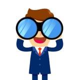 Businessman looking through binocular Stock Images