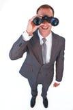Businessman looking through binoculars Royalty Free Stock Photo