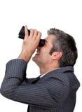 Businessman looking through a binoculars Stock Photos