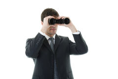 Businessman looking through a binoculars. Concepts: looking for opportunities, look at the future Stock Photo