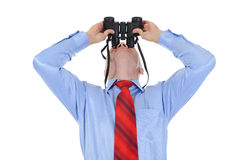 Businessman looking through binoculars Royalty Free Stock Photos
